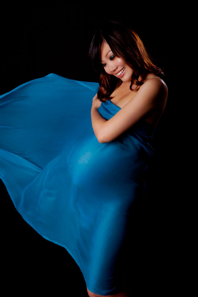 Pregnancy maternity photography studio draping flowy fabric